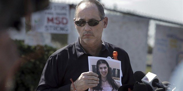 Fred Guttenberg with a picture of his daughter, Jaime. Miami Herald via AP file