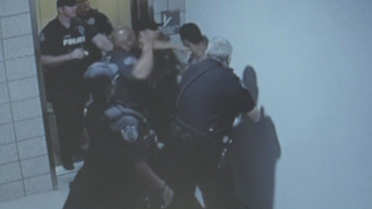 Mesa officers placed on leave after video shows them repeatedly punching man
