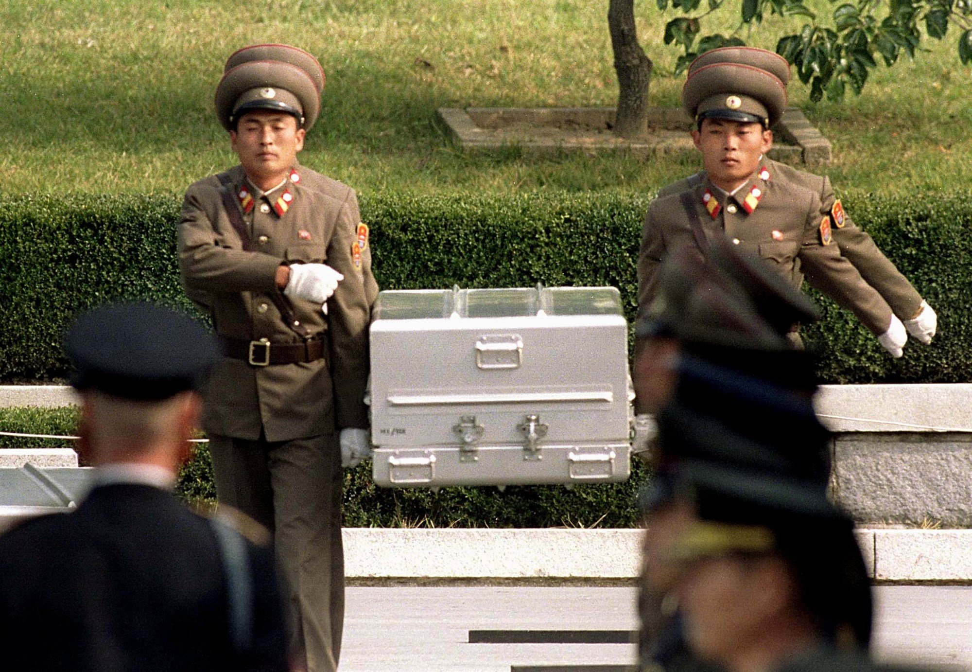 North Korean soldiers carry a coffin believed to contain the remains of a U.S. soldier to the border with South Korea during repatriation ceremonies at the truce village of Panmunjom, South Korea, in October 1998. (YUN SUK BONG / Reuters)