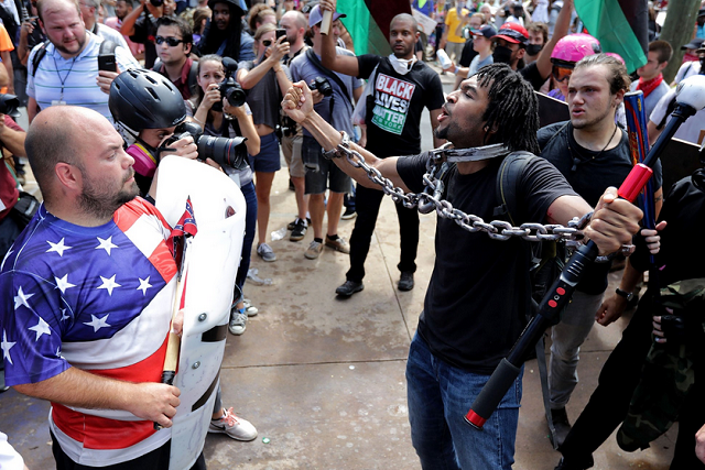 """White nationalists, neo-Nazis and members of the """"alt-right"""" exchange insuts with counter-protesters as they attempt to guard the entrance to Lee Park during the """"Unite the Right"""" rally on Aug. 12, 2017 in Charlottesville, Virginia.Chip Somodevilla / Gett"""