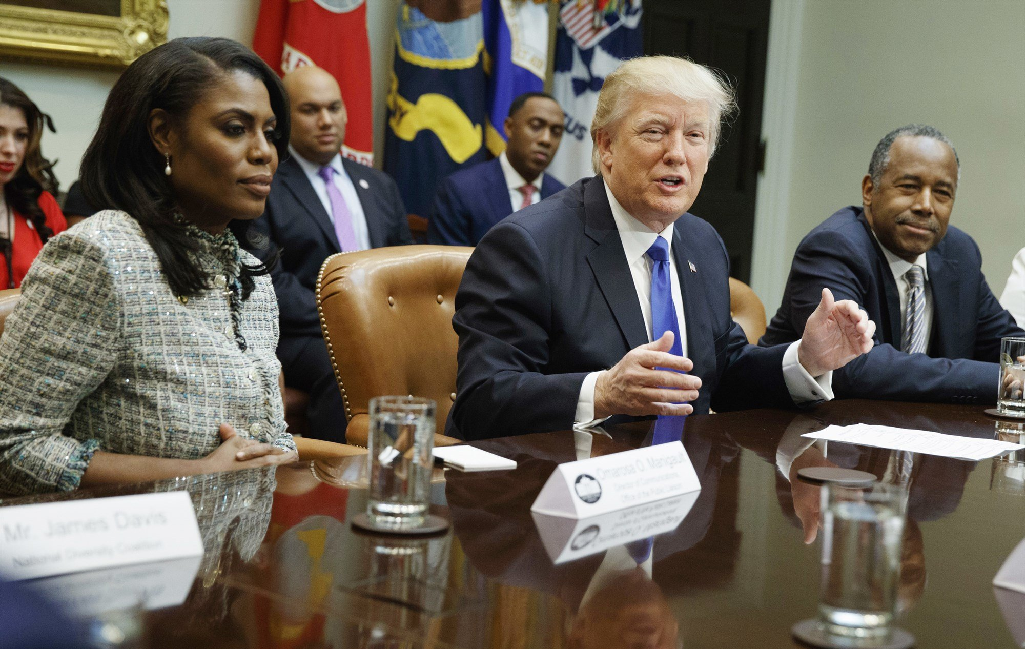 President Donald Trump with White House staffer Omarosa Manigault Newman, left, at an African American History Month meeting at the White House on Feb. 1, 2017.Evan Vucci / AP file
