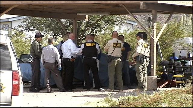 Pima County Sheriff Department deputies serving search warrant on Avra Valley house