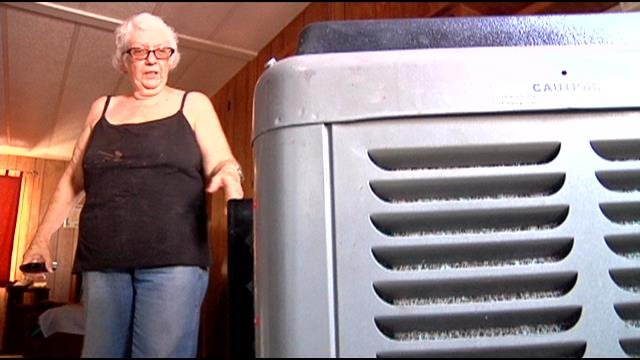 The couple's air conditioner was on the fritz and their bills continued to pile up