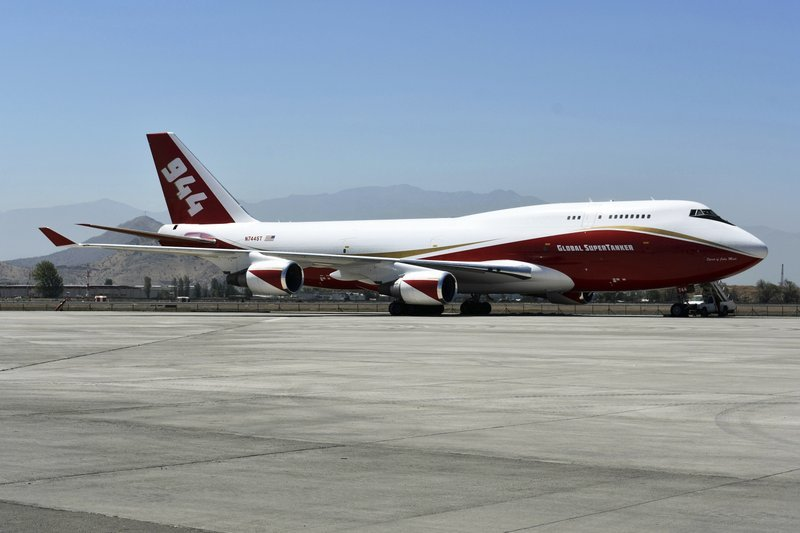 This January 2017 photo provided by Global Supertanker Services shows a Boeing 747 at an airport in Santiago, Chile. The company with the 747 retardant bomber that can drop nearly 20,000 gallons (75,000 liters) on wildfires.