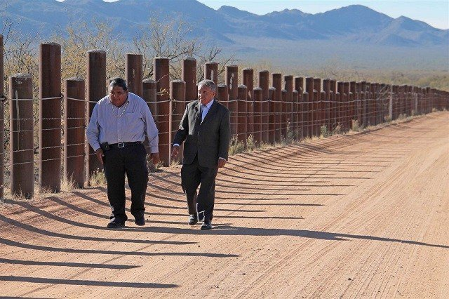 Tohono O'odham Nation Chairman Edward Manuel, right, and Vice Chairman Verlon Jose walk along the U.S.-Mexico border. Photo: Megan Siquieros