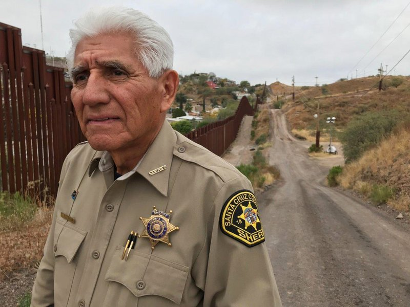 In this Dec. 5, 2017, photo, Santa Cruz County Sheriff Tony Estrada poses for a photo in Nogales, Ariz., on the U.S. international border. Estrada has spent his entire 74 years near this border, the last 50 as a law enforcement officer.